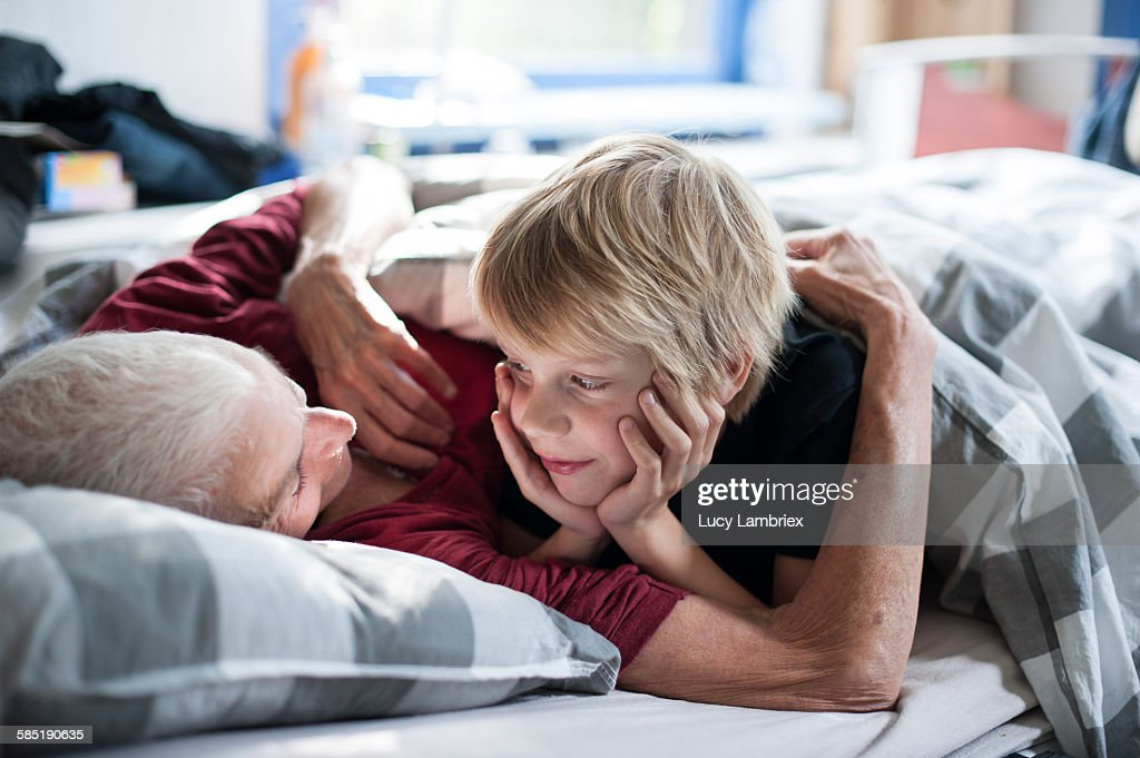 Young boy looking at his grandmother : Stock Photo