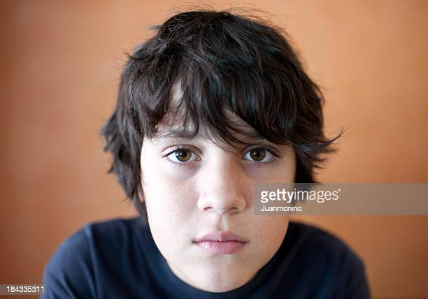 young boy looking at the camera