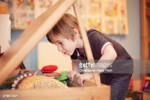 Young boy looking for toys