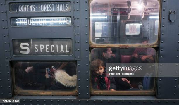 A young boy looks out from a window on the Metropolitan Transit Authority 'Nostalgia' vintage subway train on December 15 2013 in New York City The...