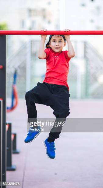 Young boy make sport workout on the street