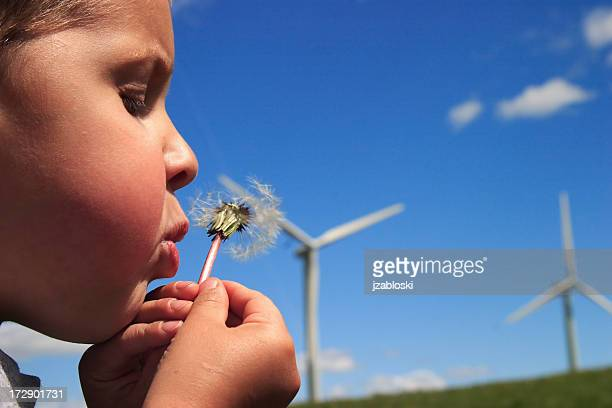 Young boy making a wish for the future