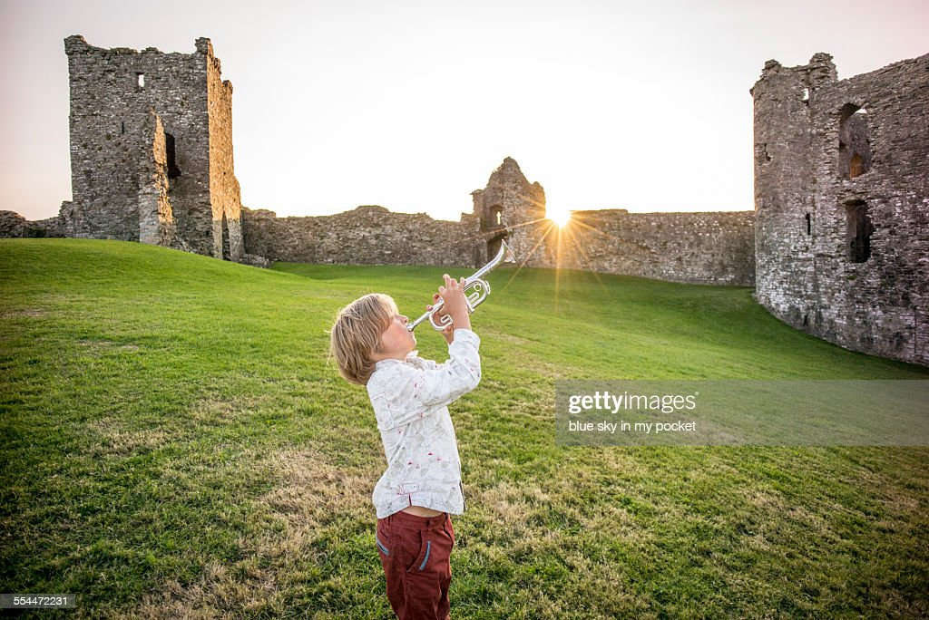 A young boy making music in a Castle