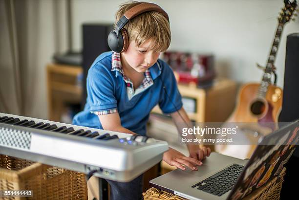 A young boy making music