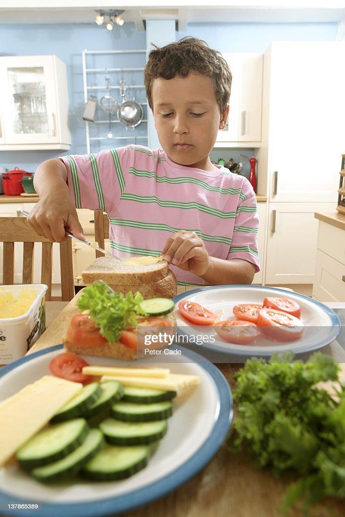 young boy making sandwich : Stock Photo