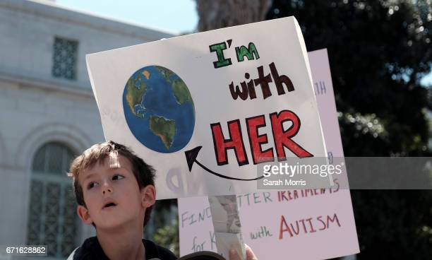 A young boy marches with scientists and supporters in a March for Science on April 22 2017 in Los Angeles California The event is being described as...