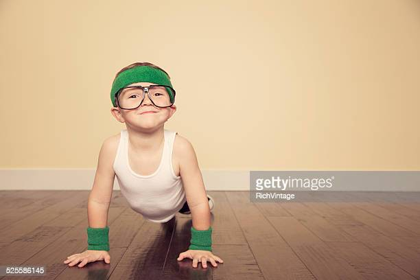 Young Boy Nerd doing Pushups in Studio
