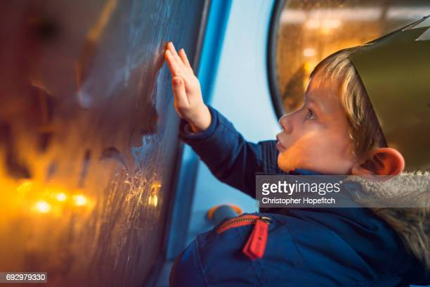 Young boy on a bus at night