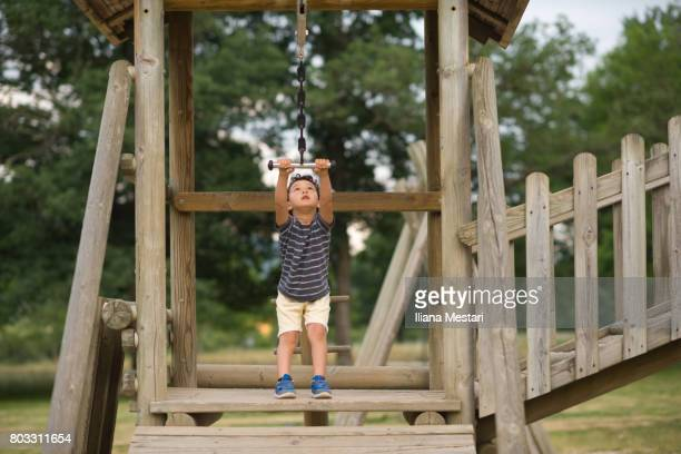 A young boy on a zip line
