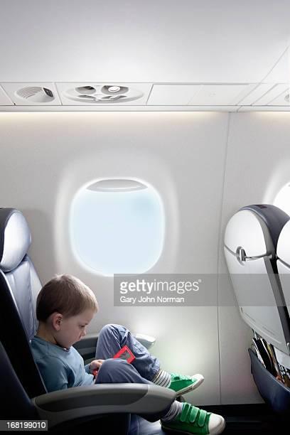 young boy on aeroplane