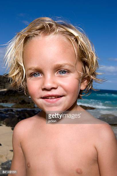 Young boy on beach, close up
