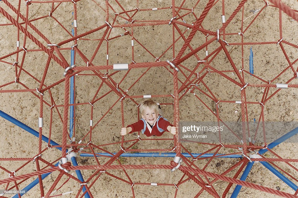 Young Boy on Jungle Gym