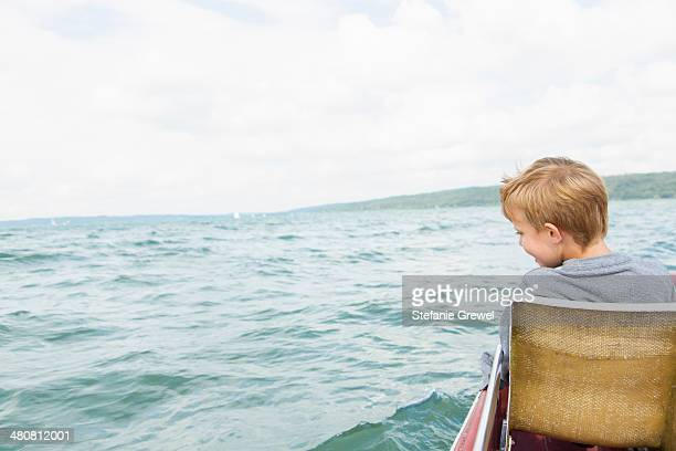 Young boy on pedalo, Lake Ammersee, Bavaria, Germany