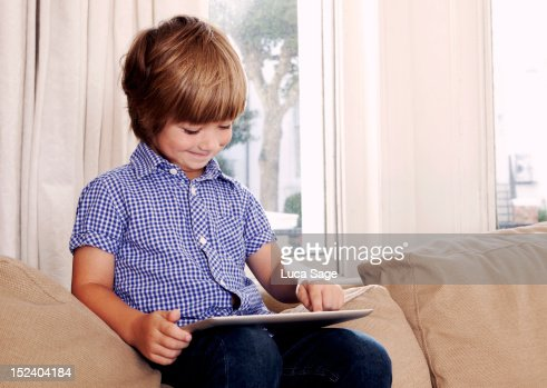 Young boy on tablet : Stock Photo