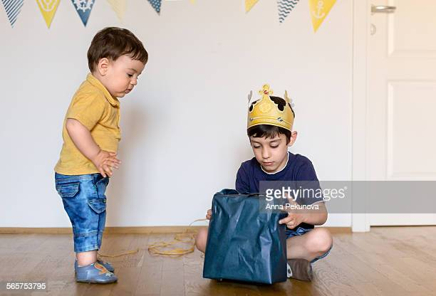Young boy opening birtday present