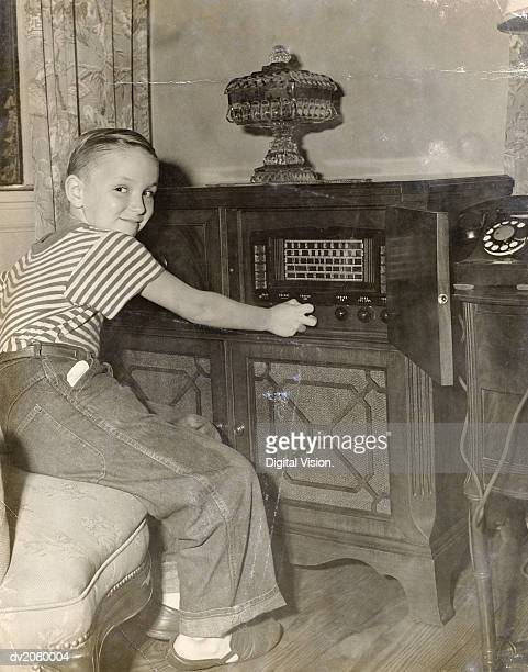 Young Boy Operating a Radio in His Living Room