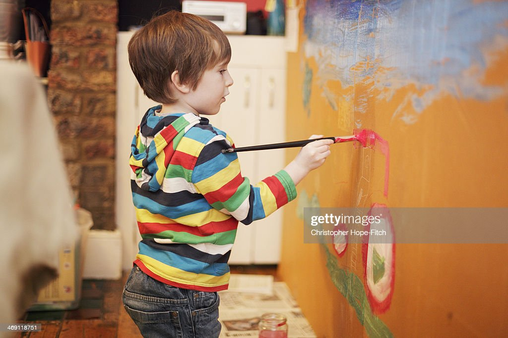Young boy painting : Stock Photo