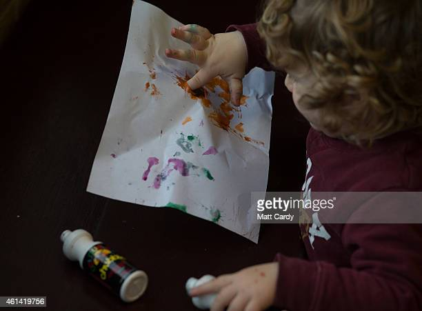 A young boy paints at a playgroup for preschool aged children in Chilcompton near Radstock on January 6 2015 in Somerset England Along with the...