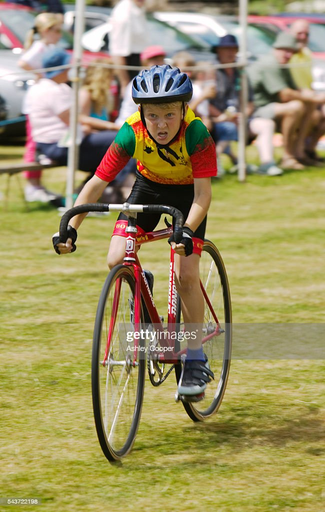 A young boy participates in a bicycle race during the annual Ambleside Sports competition at Rydal Park in the Lake District
