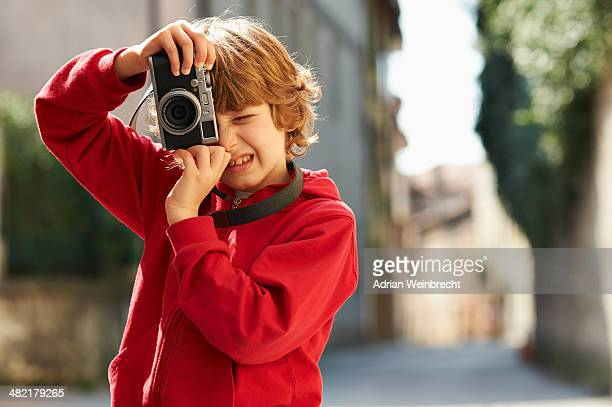Young boy photographing on street, Province of Venice, Italy