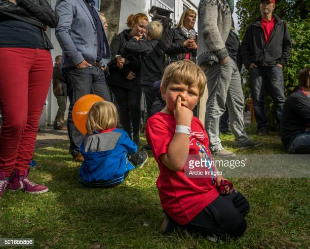 Young boy picking his nose at the annual end of the summer festival in Reykjavik, Iceland