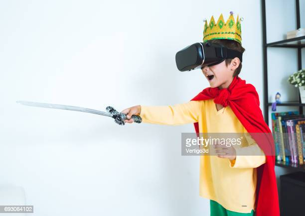 Young boy play the video game with Virtual Reality