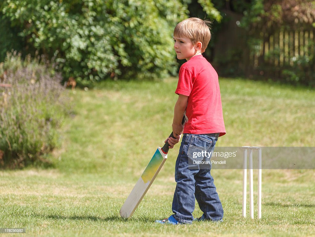 Young boy playing cricket