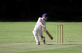 A young boy is playing a big cricket shot with a lot of confidence.
