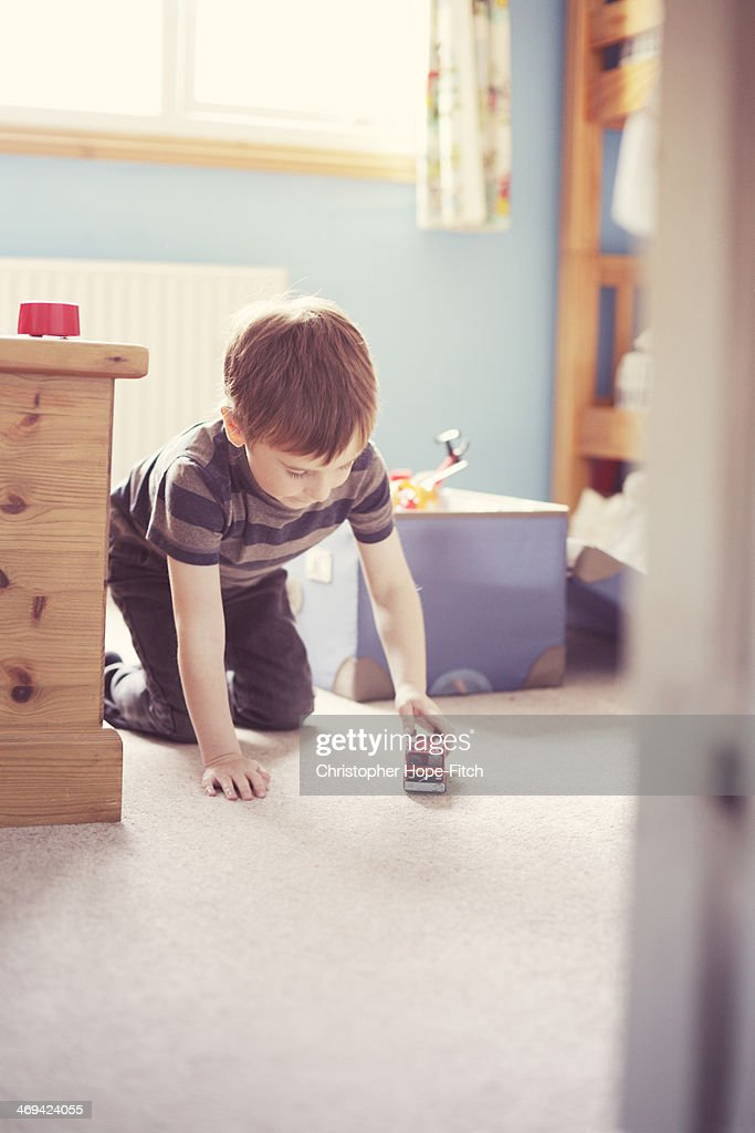 Young boy playing in his bedroom : Stock Photo