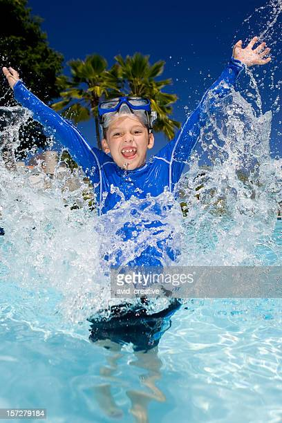 Young Boy Playing in Water