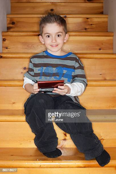 Young boy playing on video game console