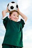 Young boy playing soccer in organized league game