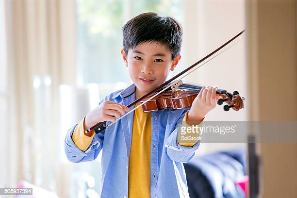 Young Boy Playing Violin