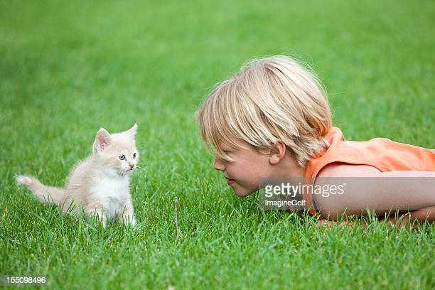 Young Boy Playing with a Cute Kitten