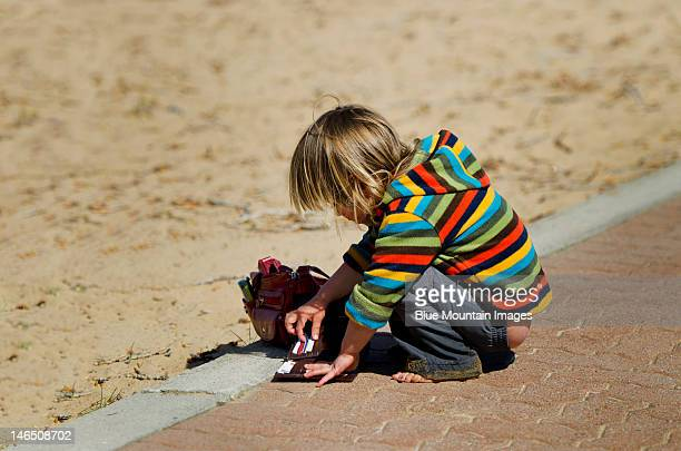 Young boy playing with credit card