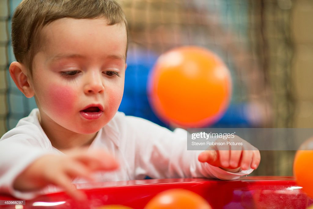 Young boy playing with floating balls : Stock Photo