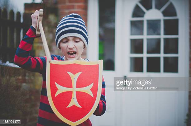 Young boy playing with sword and shield