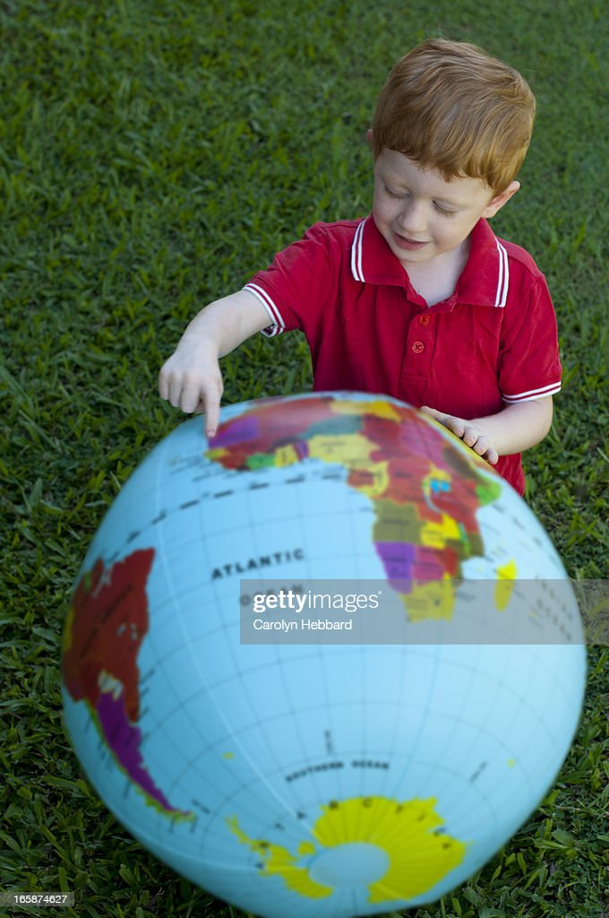 Young Boy Playing With World Globe : Stock Photo