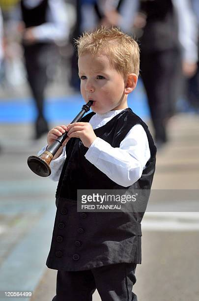 A young boy plays Breton bagpipes on August 7 2011 in Lorient during the celtics nations Great Parade of the 'festival interceltique de Lorient' It...