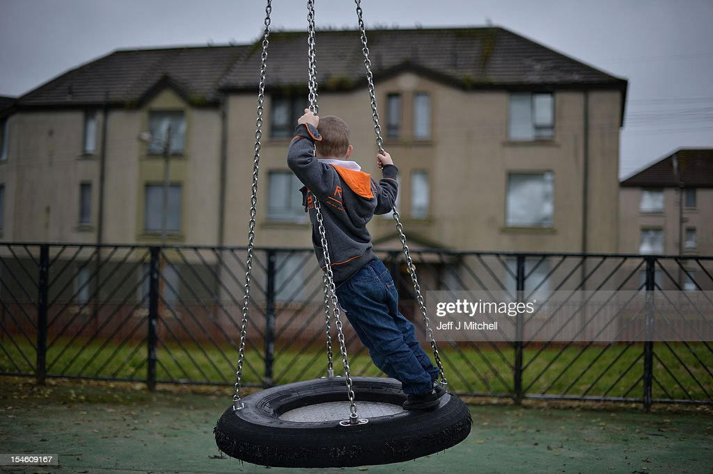 A young boy plays in a play park near disused housing in the Hamiltonhill area on October 23, 2012 in Glasgow, Scotland. The Scottish National Party (SNP) have announced a welfare fund to provide emergency support to disadvantaged people who are struggling with issues such as unemployment, low income, poor health and lack of educational qualifications.