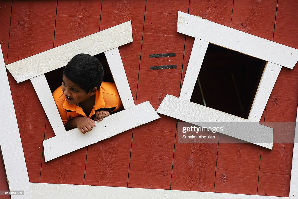 A young boy plays inside a tree house at the Sentosa Flowers exhibition at Palawan Beach on February 11, 2013 in Singapore. Millions of spring flowers decorate the island in celebration of the Chinese New Year, the year of the Snake.