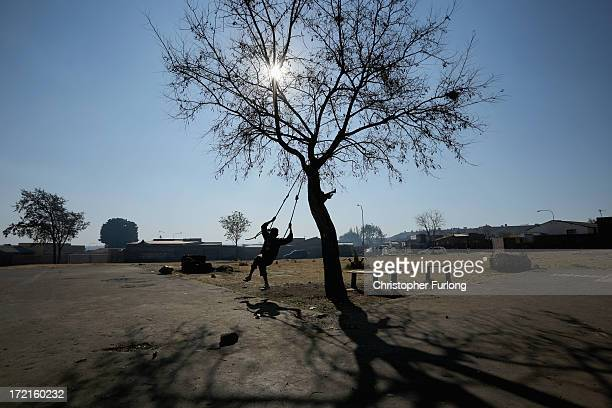 A young boy plays on a tree swing in the Orlando West section of Soweto Township on July 2 2013 in Soweto Johannesburg South Africa Nelson Mandela...