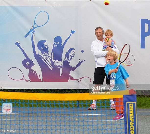 A young boy plays tennis with his family during the LTA Great British Tennis Weekend on May 17 2014 in Ealing England