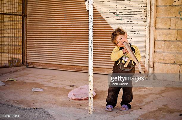 A young boy plays with a toy gun in the town of Binnish on April 9 2012 in Syria Conitnuing violence in northern Syria between government forces and...