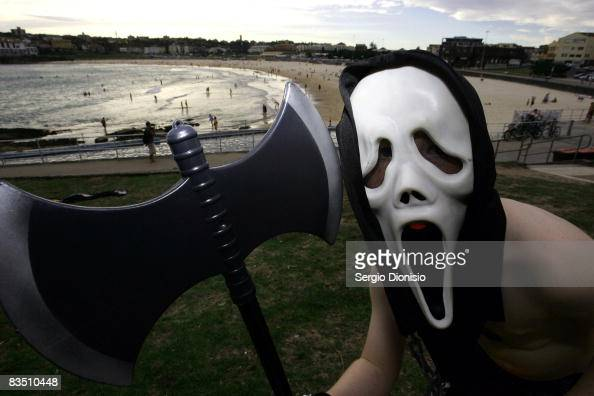A young boy poses in a 'Scream' mask with an axe on Halloween in North Bondi on October 31 2008 in Sydney Australia Halloween also known as...
