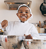 Young Boy Preparing Food With Flour on His Nose