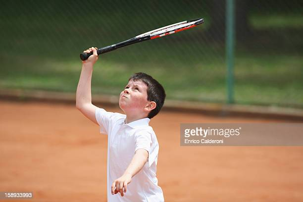 Young Boy Preparing For Hitting Shot