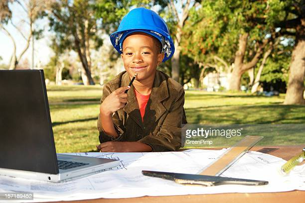 Young boy pretending to be an engineer outdoors