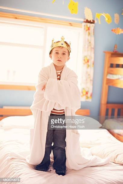 Young boy pretending to be king