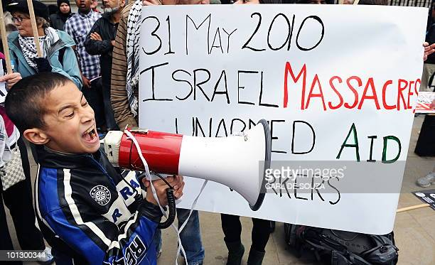A young boy protests outside Downing St London on May 31 2010A large demonstration took place in London after more than 10 people were killed by...
